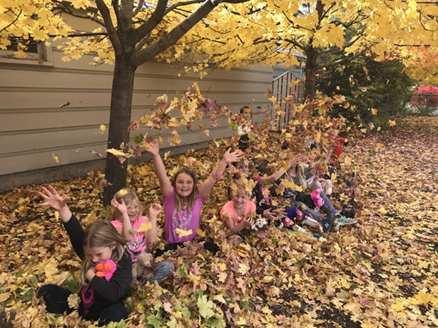 Kids at Highland Elementary play in the leaves during their time in Bend Park and Recreation District's Kids Inc. program. - BEND PARK AND RECREATION DISTRICT