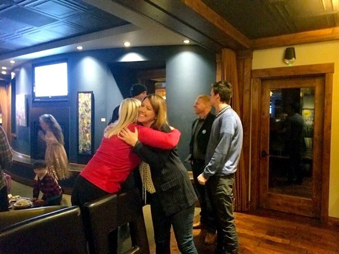 Cheri Helt hugs a supporter during her election night party Tuesday night. - AMANDA KLINGMAN