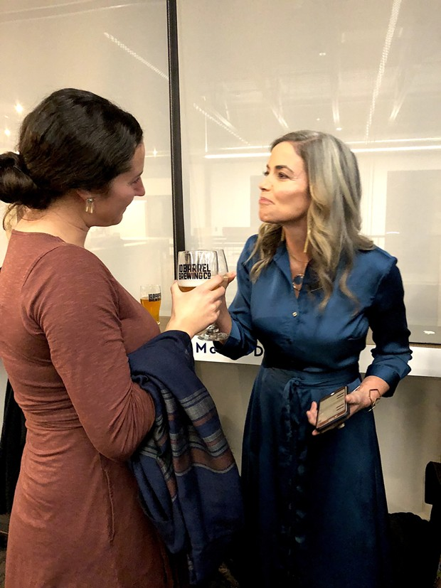 Gena Goodman-Campbell and Amy Lowes mingle at a Democratic election party Tuesday night. - CHRIS MILLER
