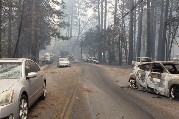 Drivers abandoned their cars to get away from the fire in Paradise, Calif. - MEREDITH J. COOPER, CHICO NEWS & REVIEW