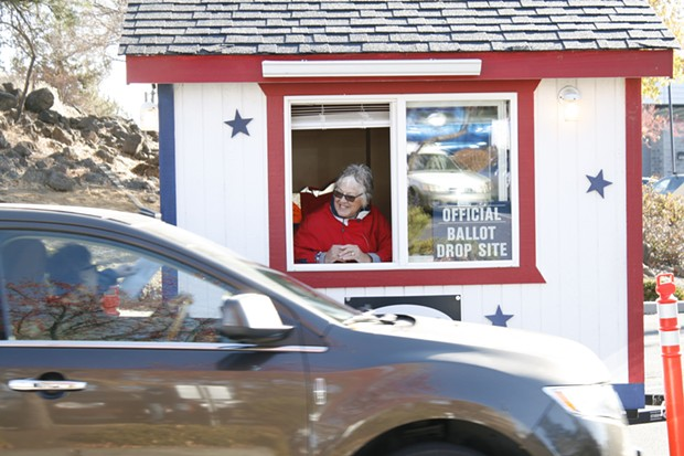 Deschutes County's drive-through ballot drop site was a busy place Nov. 6. - CHRIS MILLER