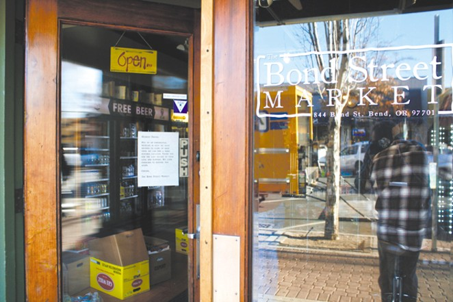 "On Thursday, Nov. 8, workers cleared out the Bond Street Market. The bodega served downtown Bend for over 7 years, but is moving because of an ""exponential increase"" in rent, according to owner Rian Steen. - CHRIS MILLER"