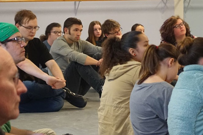 """West Side Story"" actors listen before rehearsal. - ELIZABETH WARNIMONT"