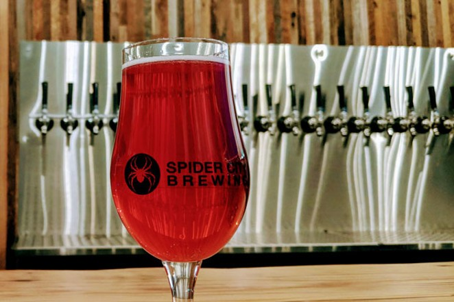 Spider City's taproom opens to the brewery. - HEIDI HOWARD
