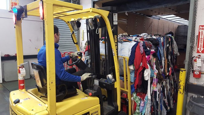 Unsold clothing donations at Bend Goodwill are bundled into bales for salvage. - GOODWILL INDUSTRIES