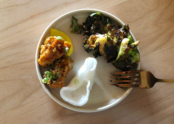 The appetizers, sweet and sour Korean chicken bitz and crispy, sweet brussels sprouts, were so delicious I didn't want to share. - LISA SIPE