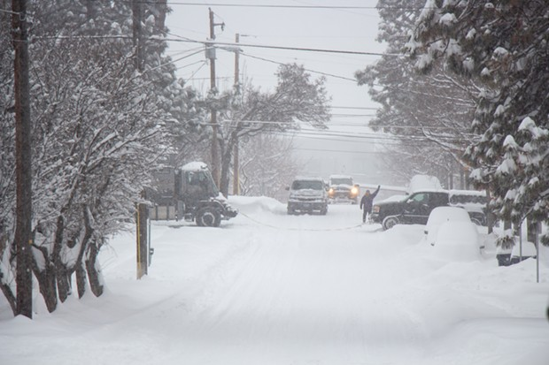 A truck gets a helping hand out of a driveway in Bend during a snow storm on Feb. 25, 2019. - KEELY DAMARA