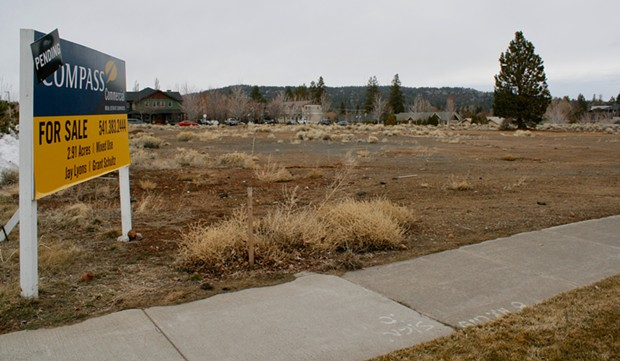 The bare land by The Pavilion where 170 apartments could be going up if a LUBA appeal is denied. - CHRIS MILLER