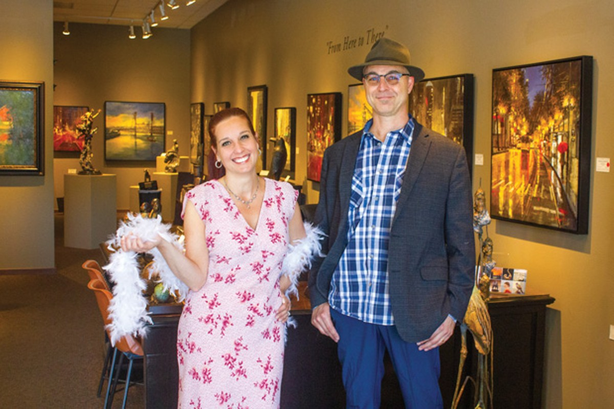 Jim Peterson, at right, with an employee of the gallery. - DARRIS HURST