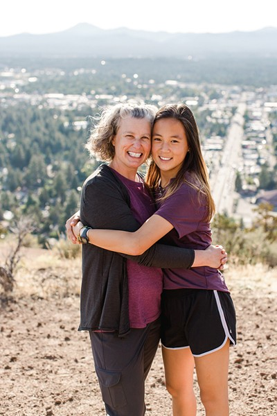 Robin and Hai Xing Lewis atop Pilot Butte. - NATALIE STEPHENSON