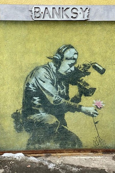 "The best known Banksy art in Park City, ""Camera Man and Flower,"" is located in an alley right off Main Street downtown. It appeared during the 2010 festival, coinciding with the street art documentary, ""Exit Through the Gift Shop,"" directed by the underground graffiti artist. It has been framed and covered with bullet-proof glass for protection. - COURTESY FLOY SITTS"
