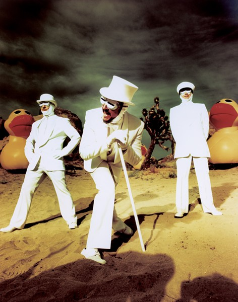 The members of Primus, in white-suit glory. - CHAPMAN BAEHLER