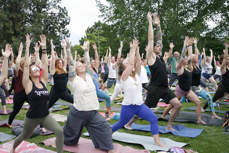 Yogis get their Warrior One on during the pre-show yoga sesh at the Art Station Tuesday. - ANNE PICK