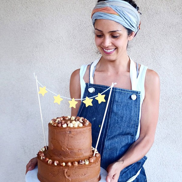 Karla Diaz Cano bakes clean, healthy cakes for Rawmona's Kitchen. Rawmona started as an illustration but you can still buy her on a greeting card when you visit Rawmona's Kitchen. - LISA SIPE
