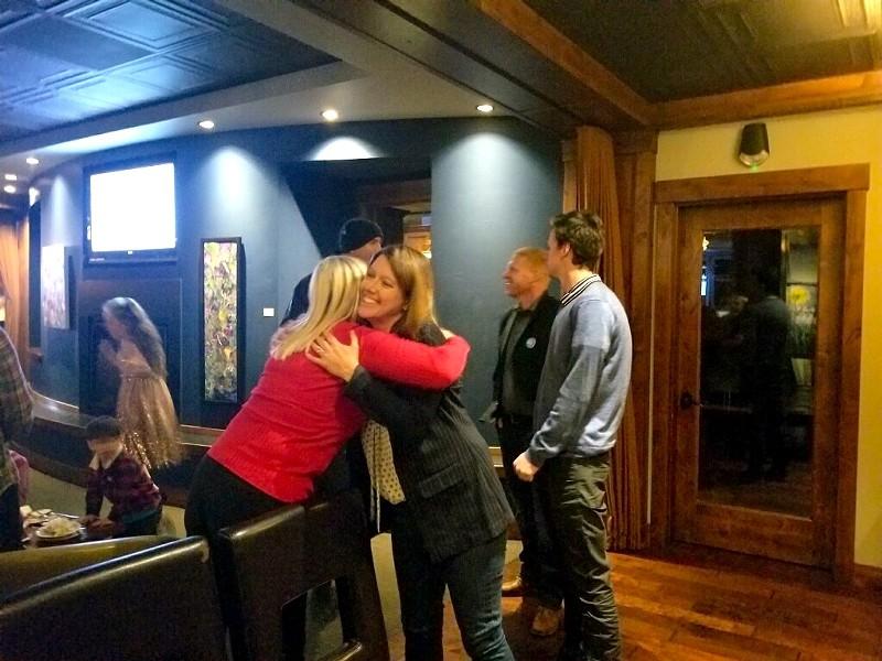 Cheri Helt hugs a supporter during her election night party Tuesday night. - AMANDA KLINGMAN