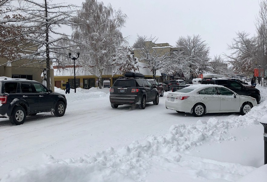 Cars squeeze past each other on Bond Street in downtown Bend Feb. 26. - CHRIS MILLER