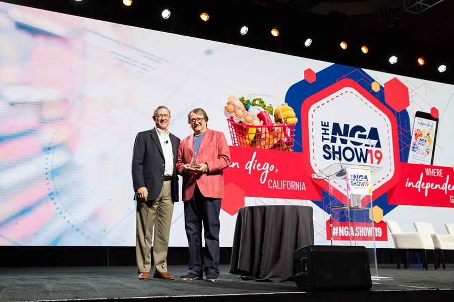 Rudy Dory accepts his award at the 2019 National Grocers Association Show. - SOFIA NEGRON