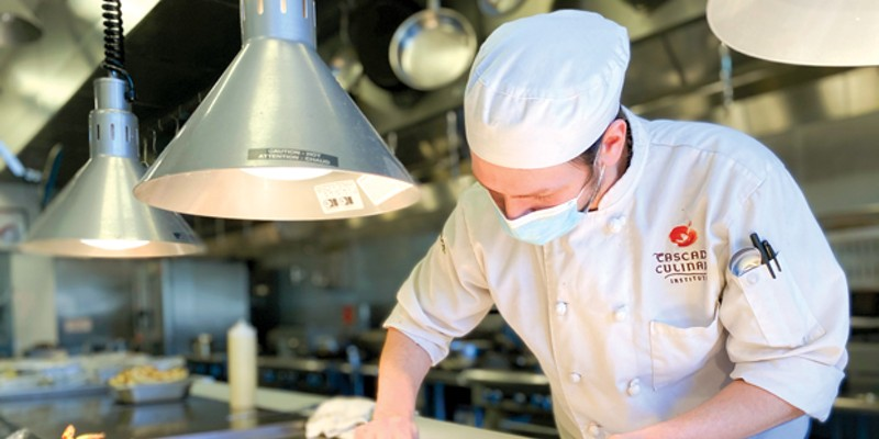 Braden Donnelly puts the finishing touches on a Chicago Beef sandwich inside Elevation's kitchen.