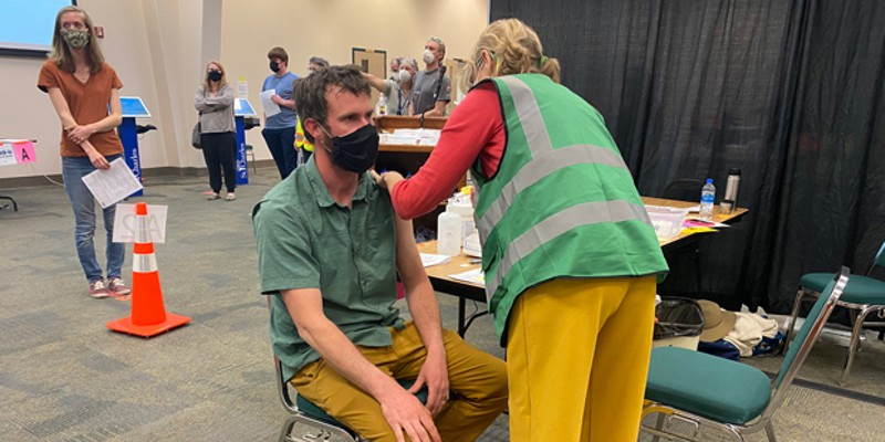 Luke Foster gets the Pfizer-BioNTech vaccine at the Deschutes County Fair & Expo Center on April 2. As of April 5, over 62,000 shots had been administered at that location, county officials said.