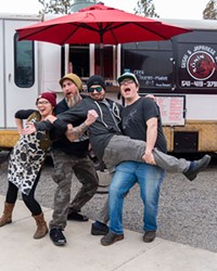 The Ronin team, from left, including Hot Line Chef Monet Rogers, Chef-Owner Scott Byers, Sushi Chef Gianni Mancuso and Sous Chef Jake Peterson, strikes a playful pose during the photo shoot with photographer Daniel Robbins.