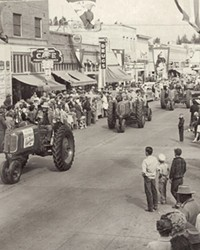 Tractors roll through downtown Redmond during the 1947 fair parade.