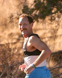 """The author running the Oct. 10, 2004 """"Just Around the Bend Marathon,"""" where he finished 28th overall, and 1st in the 50-54 age group."""