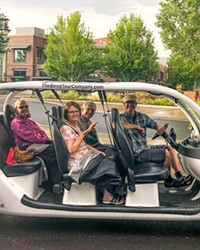 John Flannery and fellow art adventurers in The Bend Tour Company's open-air electric car.