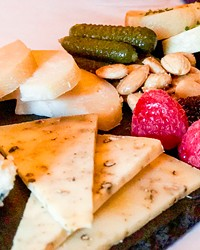 Fromagerie from the Red Martini, featuring five rich, creamy cheeses.