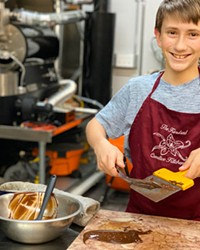 Reggie Strom tempers chocolate to make curls at Kindred Creative Kitchen.