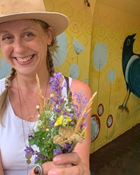 Artist Kaycee Anseth stands at the entrance to the Franklin Avenue underpass that she finished painting last summer.