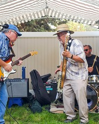 """Central Oregon union members gathered virtually on Monday for the Central Oregon Labor Chapter coalition's annual picnic. A few members attended in person to see a live performance of Thomas T and the Blue Chips. Pictured above Stu Kinzel (left) and Thomas Tsuneta """"Thomas T.""""."""
