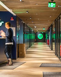 Is Spotify's logo green because they love money? We don't know. But that wouldn't be hard to believe at this point.