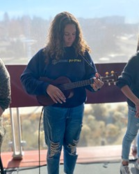 """Melodi Johnson, at left, with twins Shiloh Johnson and Abigail Johnson, at their first """"official"""" show during Bend Roots Revival in October."""