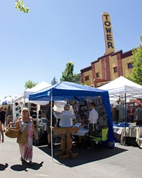 Booths line the street featuring art, vendors, businesses and more at the Bend Summer Festival.