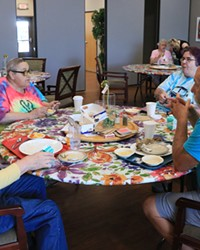 Susan Daggett, Maggi O'Brien, Marie O'Brien and Bill Graves join each other for lunch at the Redmond Senior Center. The center was shut down for over a year during the COVID-19 pandemic.