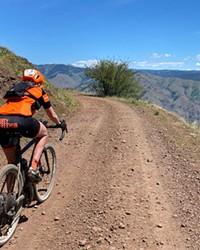 Linda English pedals up a gravel inclineoutside of Joseph, Oregon.
