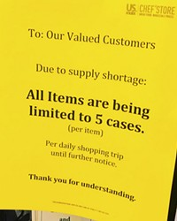 A sign announces that cases are limited at US. Foods' Chef's Store in Bend.