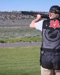 A Mountain View High School trap shooter practices at the range.