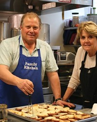 Steve Nase and Kathy Drew, volunteers with Family Kitchen, help prep food.