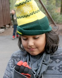 """This Outdoor School student is the recipient of the """"Purple Bead Award"""" earned for his house-keeping and cooperative excellence at Camp Tamarack Outdoor School."""