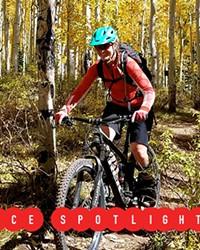 Jane Quinn rides her bike on a dirt trail.
