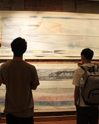 Jamaica Sweet, Ryan Martin, Andrew Leung and Clark Miyamoto observing Bill Hoppe's art from the 1970s.
