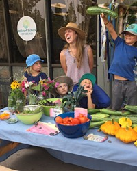 """Kindergarteners from the Waldorf School of Bend staff their own """"farmers market"""" from the school's garden."""