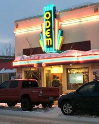 The new, brightly lit Odem Theater sign features the letters from the original, 1930s-era sign.