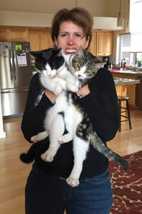 Lori Lubbesmeyer with her three adopted kitties. - SUBMITTED