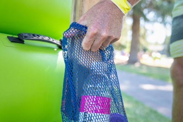 A full mesh bag trash receptacle,post-Green Tube floating. - NATE WYETH