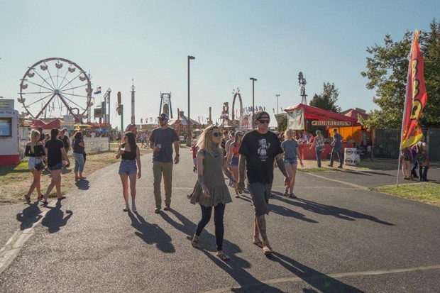 Visitors stroll along the midway at the Deschutes County Fair + Rodeo. - DESCHUTES FAIR AND EXPO CENTER