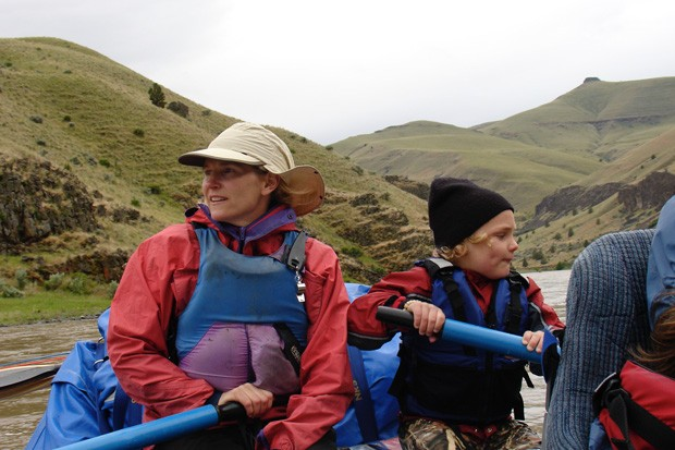 Beth Jacobi and son Orion row a raft down the John Day River together. - COURTESY BETH JACOBI