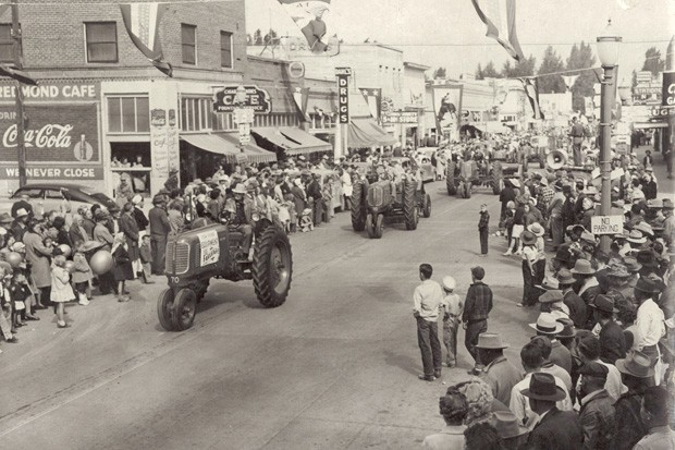 Tractors roll through downtown Redmond during the 1947 fair parade. - COURTESY ROSS ROGERS AND THE DESCHUTES COUNTY FAIR & RODEO