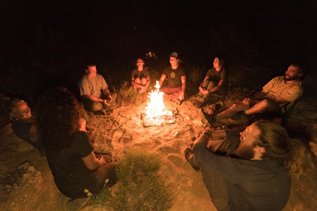 Evoke Therapy field staff relax around a campfire. - COURTESY EVOKE THERAPY PROGRAMS